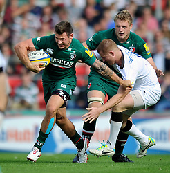 Leicester Tigers winger Niall Morris fends Newcastle Falcons fly half Rory Clegg - Photo mandatory by-line: Patrick Khachfe/JMP - Tel: Mobile: 07966 386802 - 21/09/2013 - SPORT - RUGBY UNION - Welford Road Stadium - Leicester Tigers v Newcastle Falcons - Aviva Premiership.