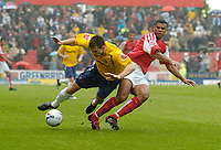 Photo: Henry Browne.<br /> Swindon v Nottingham Forest. Coca Cola League 1.<br /> 13/08/2005.<br /> Scott Dobie of Forest is knocked off the ball by Jerel Ifil of Swindon.