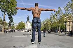 A man with his body covered with racist insults poses during an event organized by the Conseil Representatif des Associations Noires de France - CRAN (Representative Council of France's Black Associations) to protest against racism, on the place de la Republique in Paris, France, on April 24, 2017, one day after moderate candidate Emmanuel Macron won the first round of France's presidential election and looked set to triumph in the run-off against far-right candidate Marine Le Pen next month. Photo by Alain Apaydin/ABACAPRESS.COM