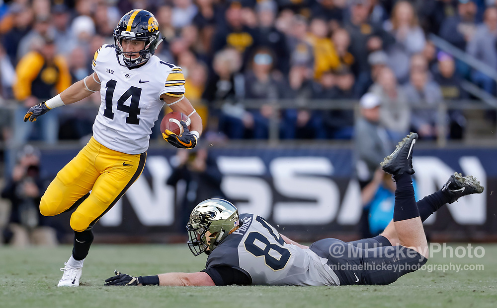 WEST LAFAYETTE, IN - NOVEMBER 03: Kyle Groeneweg #14 of the Iowa Hawkeyes runs the ball during the game against the Purdue Boilermakers at Ross-Ade Stadium on November 3, 2018 in West Lafayette, Indiana. (Photo by Michael Hickey/Getty Images) *** Local Caption *** Kyle Groeneweg