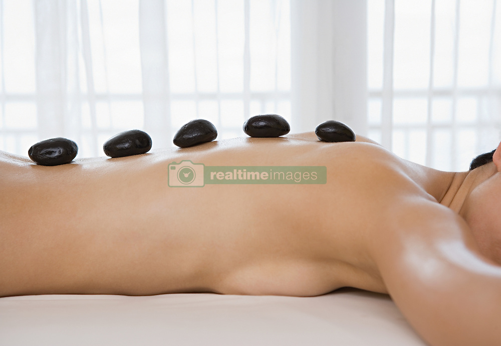 Dec. 14, 2012 - Woman having Lastone therapy (Credit Image: © Image Source/ZUMAPRESS.com)