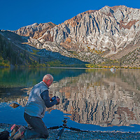 Photographers take pictures of Laurel Mountain refleted in Convict Lake in the eastern Sierra Nevada near Mammoth Lakes, California.