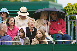 LONDON, ENGLAND - Friday, June 27, 2008: A couple shelter under an umbrella as the first drops of rain fall at Wimbledon during a third round match on day five of the Wimbledon Lawn Tennis Championships at the All England Lawn Tennis and Croquet Club. (Photo by David Rawcliffe/Propaganda)
