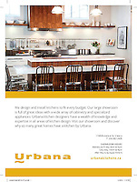 Shot on location at the Urbana Kitchen showroom, this image shows an industrial-styled contemporary kitchen with walnut and white quartz, open shelving and stainless accents.