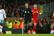 Referee Mark Clattenburg looks on. Premier League match, Liverpool v West Ham Utd at the Anfield stadium in Liverpool, Merseyside on Sunday 11th December 2016.<br /> pic by Chris Stading, Andrew Orchard sports photography.
