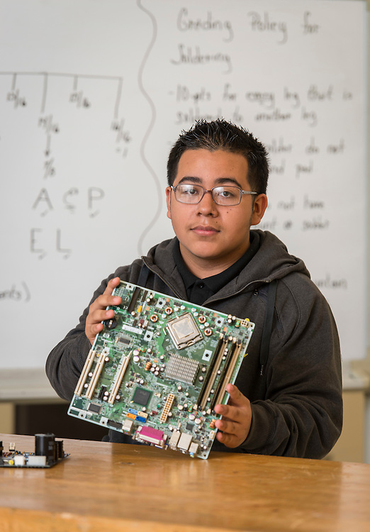 Wheatley High School student Roberto Cervantes poses for a photograph in a STEM class at the Barbara Jordan High School for Careers, November 21, 2016.