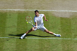 04.07.2014, All England Lawn Tennis Club, London, ENG, ATP Tour, Wimbledon, im Bild Grigor Dimitrov (BUL) during the Gentlemen's Singles Semi-Final match on day eleven // during the Wimbledon Championships at the All England Lawn Tennis Club in London, Great Britain on 2014/07/04. EXPA Pictures © 2014, PhotoCredit: EXPA/ Propagandaphoto/ David Rawcliffe<br /> <br /> *****ATTENTION - OUT of ENG, GBR*****