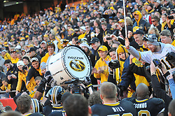 Nov 27, 2010; Kansas City, MO, USA; Missouri Tigers team members carry around the Alumni Association drum after the game against the Kansas Jayhawks at Arrowhead Stadium. Missouri won 35-7.  Mandatory Credit: Denny Medley-US PRESSWIRE