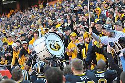 Nov 27, 2010; Kansas City, MO, USA; Missouri Tigers team members carry around the Alumni Association drum after the game against the Kansas Jayhawks at Arrowhead Stadium. Missouri won 35-7.  Mandatory Credit: Denny Medley-US PRESSWIRE