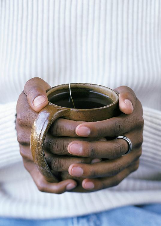 Walter Jackson, Hands wrapped around a coffee mug, tea mug