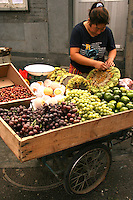 """Fruit Cart at Morning Market - Beijing's morning markets are popular with housewives shopping for fresh produce and household items.  Morning markets open extremely early with all  businesses beginning just as dawn breaks.  Therefore, this kind of morning market are also called ghost markets.  These markets spring up in regular spots throughout the city, though there is no real """"central""""  market."""