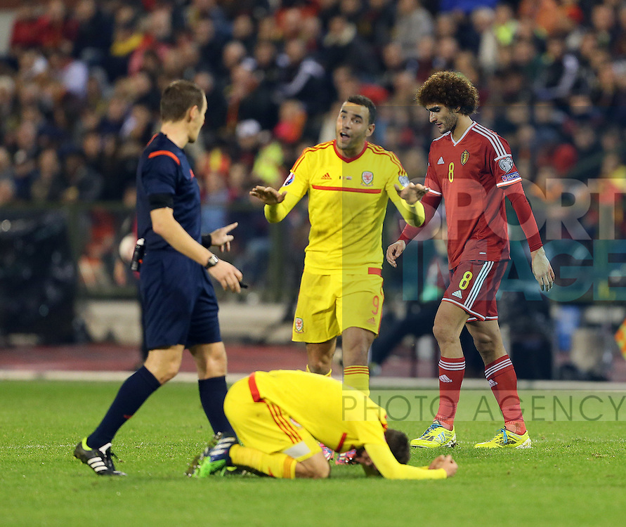 Belgium's Marouane Felaini tussles with Joe Allen leaves him with a bloodied nose<br /> <br /> - European Qualifier - Belgium vs Wales- Heysel Stadium - Brussels - Belgium - 16th November 2014  - Picture David Klein/Sportimage