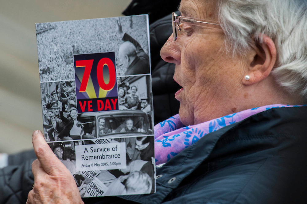 The crowd join in with the memorial service in Whitehall. VE Day 70 commemorations - Three days of events in London and across the UK marking historic anniversary of end of the Second World War in Europe. Trafalgar Square, scene of jubilant celebrations marking the end of the Second World War in Europe on 8 May 1945, plays a central part in a host of national events, which include a Service of Remembrance at the Cenotaph, a concert in Horse Guards Parade, a Service of Thanksgiving at Westminster Abbey, a parade of Service personnel and veterans and a flypast.