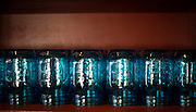 Blue mason jars at The Farmer's Table in Fayetteville, Arkansas. A farm to table, local and organic, restaurant in Northwest Arkansas.<br /> Photo by Beth Hall