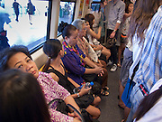 "09 OCTOBER 2009 -- BANGKOK, THAILAND: Passengers on the Sukhumvit line of the Bangkok ""Skytrain,"" BTS system. PHOTO BY JACK KURTZ"