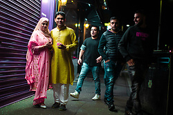 © Licensed to London News Pictures. 05/06/2019. Manchester, UK. Wife and husband NAFISA SIDDIQUE (20) and YUSUF MOHAMMED (34) from Oldham . People celebrate Eid-ul-Fitr , the end of a month of fasting during Ramadan , in Rusholme in Manchester . Photo credit: Joel Goodman/LNP