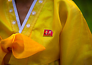 Fashion in North Korea<br /> <br /> In every corner of the earth, women love to look beautiful and keep up with the latest fashion trends. The women of North Korea are no different. Fashion is taken seriously here. But in North Korea, women do not read Elle or Vogue; they just glimpse a few styles by watching TV or by observing the few foreigners who come to visit. In the hermit kingdom, clothing also reflects social status. If you have foreign clothes it means you travel and are consequently close to the centralized power. Chinese products have inundated the country, adding some color to the traditional outfits that were made of vynalon fiber. But citizens beware, too much style means you're forgetting the North Korean juche, the ethos of self-reliance that the country is founded on! But the youth tend to neglect it despite the potential consequences.<br /> <br /> Photo shows: Whatever the choice of attire, the Dear Leaders badge must be worn over the heart.<br /> ©Eric Lafforgue/Exclusivepix Media
