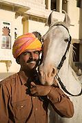 Hemant Deval with his horse at Ravla Khempur near Udaipur, Rajasthan, India.