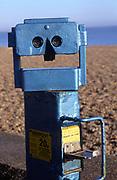Seaside binoculars  shaped like a human face by the beach, Aldeburgh, Suffolk, England, UK