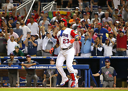 March 11, 2017 - Miami, FL, USA - The Dominican Republic's Nelson Cruz hits a three-run home run during the eighth inning against the United States in a World Baseball Classic first round Pool C game at Marlins Park in Miami on Saturday, March 11, 2017. The Dominican Republic won, 7-5. (Credit Image: © David Santiago/TNS via ZUMA Wire)
