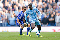 Yaya Toure of Manchester City is challenged by Nemanja Matic of Chelsea - Photo mandatory by-line: Rogan Thomson/JMP - 07966 386802 - 21/08/2014 - SPORT - FOOTBALL - Manchester, England - Etihad Stadium - Manchester City v Chelsea FC - Barclays Premier League.