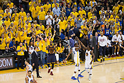 Golden State Warriors forward Kevin Durant (35) and Golden State Warriors forward Draymond Green (23) celebrate during a timeout as Cleveland Cavaliers forward LeBron James (23) reacts to a turnover during Game 1 of the NBA Finals at Oracle Arena in Oakland, Calif., on June 1, 2017. (Stan Olszewski/Special to S.F. Examiner)