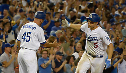 July 28, 2017 - Los Angeles, California, U.S. - Los Angeles Dodgers' Corey Seager (5) high fives third base coach Chris Woodward (45) after hitting a two run home run agains the San Francisco Giants in the seventh inning of a Major League baseball game at Dodger Stadium on Friday, July 28, 2017 in Los Angeles. (Photo by Keith Birmingham, Pasadena Star-News/SCNG) (Credit Image: © San Gabriel Valley Tribune via ZUMA Wire)