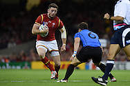 Alex Cuthbert of Wales looks to go past Juan Gaminara of Uruguay. Rugby World Cup 2015 pool A match, Wales v Uruguay at the Millennium Stadium in Cardiff, South Wales  on Sunday 20th September 2015.<br /> pic by  Andrew Orchard, Andrew Orchard sports photography.