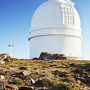 This telescope is one of 5 at the Calar Alto observatory located north of Almeria, Spain, on Calar Alto mountain in Sierra de Los Filabres (altitude: 2168 meters / 7113 ft). Run by the Max Planck Institute for Astrophysics and the Institute of Astrophysics of Andalusia, the site has telescopes ranging in size from 0.8 to 3.5 meters.