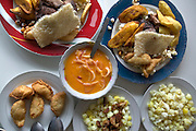 The town of Latacunga's lunchtime specialty: chugchucaras (pork, bananas, corn, and empanadas), Latacunga, Ecuador. (From a photographic gallery of meals in Hungry Planet: What the World Eats, p. 245).