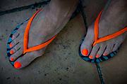 Orange thongs, orange painted toenails.