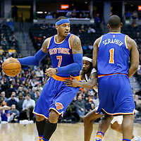08 March 2016: New York Knicks forward Carmelo Anthony (7) drives past Denver Nuggets forward Will Barton (5) on a screen set by New York Knicks center Kevin Seraphin (1) during the Denver Nuggets 110-94 victory over the New York Knicks, at the Pepsi Center, Denver, Colorado, USA.