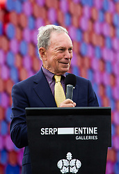 Michael Bloomberg addresses the gathered media and dignitaries as Artist Christo unveils his 20m high installation on The Serpentine made from over 7000 barrels, titled The Mastaba, which will be on the Serpentine until 23 September 2018. The Installation is comprised of 7,506 horizontally stacked barrels. It is 20m high, 30m wide and 40m long. Hyde Park, London, June 18 2018.