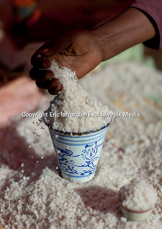 EL SOD: THE SALT OF LIFE<br />  <br />  El Sod, the House Of Salt, is a village located 90 km from Yabelo, the capital of Borana people in South Ethiopia. It stands on the edge of an extinct volcano wide of 1,8 km diameter, with a salted lake in the crater. For centuries, men dive into the lake to collect the salt and sell it across Ethiopia, Somalia and Kenya<br /> <br />  It takes 1 hour on a narrow path to go down the 2,5 km from the village to the lake, 340 meters lower. The best view on the crater can be spotted from the recently built mosque.<br /> Every miner works as a free lance, independent from any company or boss. Most of the time divers are naked, the salted water being so agressive that it destroys everything, including clothes and shoes.<br />  Miners try to protect their nose and ears with plugs made of soil wrapped in plastic bags. There's no protection for the eyes: many suffer heavily from blindness.<br />  When the weather is good after rains (Borana wait for it for months since the area suffers from drought) more than 200 men dive into the lake. More and more children are joining for the families to get some extra revenue. The parents are aware of the dangers but they don't have any choice if they want to survive.<br /> <br /> Photo Shows: Salt From Lake Assal In Djibouti, Tepi Village, Ethiopia<br /> ©Eric lafforgue/Exclusivepix Media