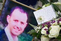 © Licensed to London News Pictures . FILE PICTURE DATED 15/07/2013 . Oldham Street , Manchester , UK .  Flowers and tributes left at the scene on Oldham Street from Stephen Hunt's mother Susan and stepfather Wilf , following a fire at Paul 's Hair World on 13th July which claimed the life of fireman Stephen Hunt . Photo credit : Joel Goodman/LNP