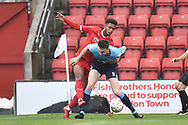 Woking defender Jack Cook (4) battles for possession  during the The FA Cup 2nd round match between Swindon Town and Woking at the County Ground, Swindon, England on 2 December 2018.