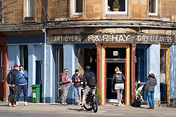 Leith, Edinburgh, Scotland, UK. 7 April 2020. In the third week of the nationwide coronavirus lockdown life in Leith continues although the streets are mostly deserted and shops closed. Pictured; Busy cafe still open on Leith Walk.