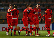 GOAL 3-2 Wigan Athletic forward Will Keane(10) is surrounded by team mates after scoring during the EFL Sky Bet League 1 match between Rochdale and Wigan Athletic at the Crown Oil Arena, Rochdale, England on 16 January 2021.