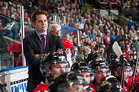 KELOWNA, CANADA - MAY 1: Kyle Gustafson, assistant coach of the Portland Winterhawks stands on the bench against the Kelowna Rockets during game 5 of the Western Conference Final on May 1, 2015 at Prospera Place in Kelowna, British Columbia, Canada.  (Photo by Marissa Baecker/Getty Images)  *** Local Caption *** Kyle Gustafson;