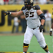 ORLANDO, FL - JANUARY 01:  Mitch Morse #65 of the Missouri Tigers sets up at the line during the Buffalo Wild Wings Citrus Bowl between the Minnesota Golden Gophers and the Missouri Tigers at the Florida Citrus Bowl on January 1, 2015 in Orlando, Florida. (Photo by Alex Menendez/Getty Images) *** Local Caption *** Mitch Morse
