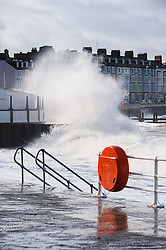 "© Licensed to London News Pictures. 23/02/2015. Aberystwyth, UK The high 'supertide' at 10.30, combined with strong winds bring huge waves crashing into the sea wall and promenade at Aberystwyth on the west wales coast . <br /> Flood warnings are in place for many 'at risk' areas on the Welsh seaboard, including Aberystwyth, with further alerts for much of the rest of the Welsh coastline. Natural Resources Wales warned of ""dangerous conditions"" that could see tides breach sea and river defences. Photo credit : Keith Morris/LNP"