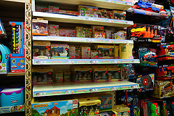© Licensed to London News Pictures. 13/10/2021. London, UK. Nearly empty shelves of toys in a toy shop in north London. Retailers are warning of toy shortages in the lead up to Christmas, amid fears of ongoing supply chain problems will result in higher prices and empty shelves. Photo credit: Dinendra Haria/LNP