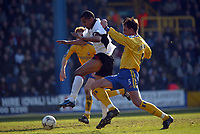 Picture: Jed Leicester<br />Date: 15/03/2003<br />Fulham  v Southampton FA Barclaycard Premiership<br />Fulham's Steve Marlet bursts in between Southampton's  Claus Lundekvam (r) and Michael Svensson