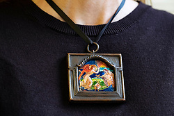 Bonhams picture specialist May Matthews wears 'Morning', an enamelled metal plaque, inscribed and dated 'Morning/1914' by Phoebe Anna Traquair HRSA (1862-1936).