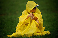 Daniel, a 6th grader from Truro Elementary in Cape Cod takes cover from the rain in Washington D.C.'s National Mall.