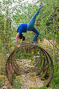 Thuli Lamb, free runner from Parkour Generations on the St Modwen properties plc:Brownfield - Metamorphosis garden designed by Martyn Wilson - The Hampton Court Flower Show, organised by the Royal Horticultural Society (RHS). In the grounds of the Hampton Court Palace, London.