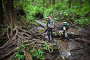 Zach Podell-Eberhard (left) and Henry show their exhaustion tackling a particularly difficult, muddy portion of the West Coast Trail, British Columbia, Canada.