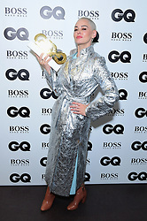 Rose McGowan in the press room with the Inspiration Award at the GQ Men of the Year Awards 2018 in Association with Hugo Boss held at The Tate Modern in London.