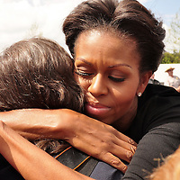 """First Lady Michele Obama embraces a visitor to the Flight 93 memorial after placing a wreath along the """"Wall of Names"""" at the Flight 93 National  Memorial on September 11, 2001. The white marble wall has the names of the 40 victims of Flight 93 that perished in a terrorist attacks of 10 ten ago near the small town of Shanksville Pennsylvania.. UPI/Archie Carpenter"""