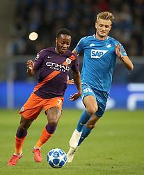 Manchester City's Raheem Sterling (left) and Hoffenheim's Stefan Posch battle for the ball